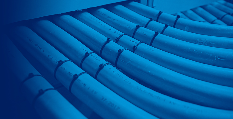 Seven white 1kV cables laying side by side